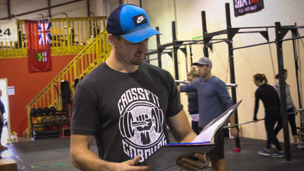 crossfit coach going over the details