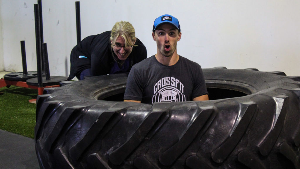 coach sitting in a large tire