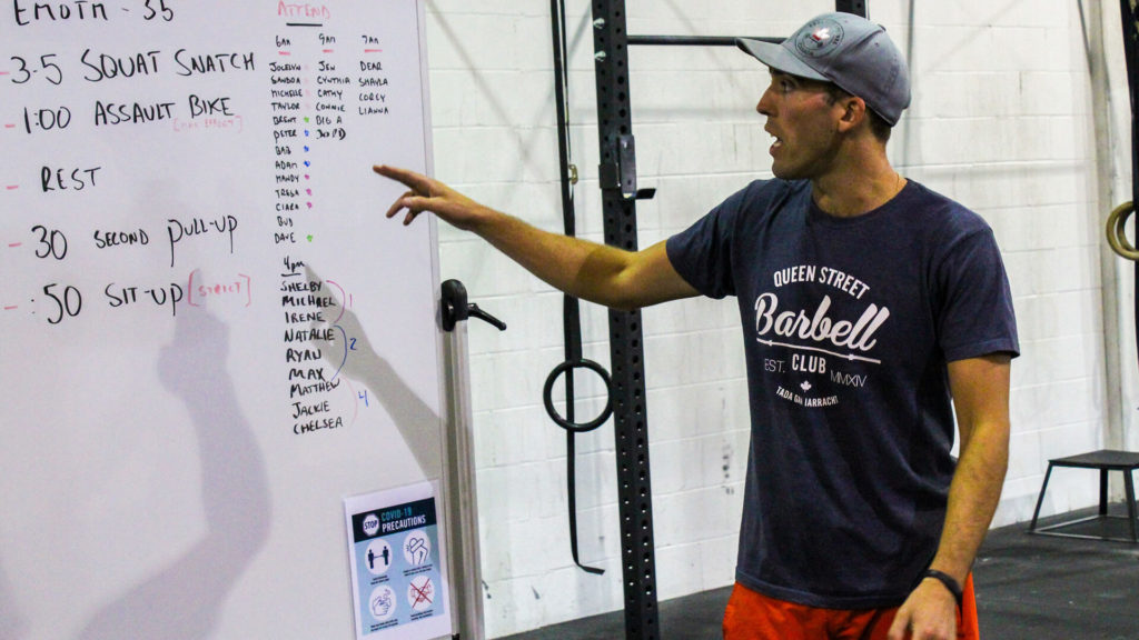 crossfit coach explaining todays class exercises