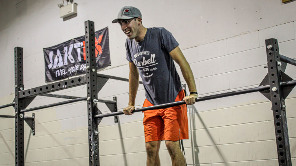 crossfit coach doing a muscle up